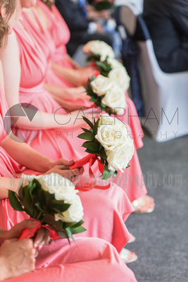 Surrey wedding photographer- Woldingham Golf Club-beautiful Bridesmaids sat down