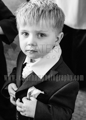 Surrey Wedding Photographer-  weald of kent golf club weddings, stunning little page boy at the wedding