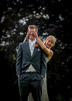 Surrey wedding photographer / Tyrrells Wood Golf Club Wedding / The bride hiding grooms eyes