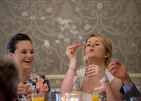 surrey wedding photographer- Crowhurst Park Wedding East Sussex- blowing bubbles