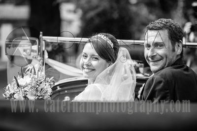 Surrey wedding photographer - Hartsfield Manor- Bride and Groom in beautiful wedding car