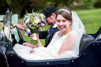 Surrey wedding photographer Hartsfield Manor  Wedding  couple in the car