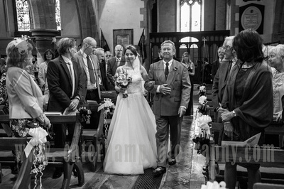 Surrey wedding photographer wedding at St Mary's Church in Dorking - Bride & Dad walking down aisle in Traditional Wedding Venue