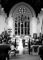 St Pauls Church, East Molesey wedding - Wedding photographer in Surrey / Wedding couple standing at the altar