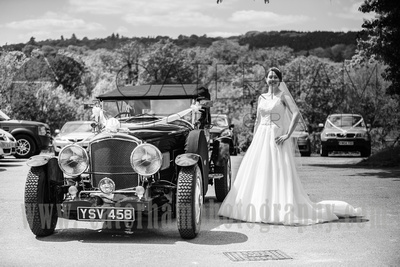 Surrey wedding photographer- Photographed Wedding at St Mary's Church in Dorking- Bride on her way to the Church