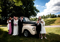Surrey wedding photographer - Reigate hill golf club- bride and groom kissing in front of kids